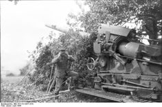 German gunners ready to fire a big howitzer. France June 1944
