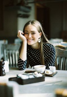 Great shot, cafe, coffee, girl, smiling. Image Via: A Feminine Tomboy