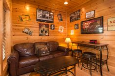 Seating nook in the game/media room. Couch is a sleeper with memory foam mattress.    Pat Kirchhoefer, owner of the cabins Escape to Times Past    #mybearfootcabins #smokymountains #pigeonforge #vacationrental #cabinlife #cabin #gatlinburg #sevierville #cabinrental #vacation #mountains