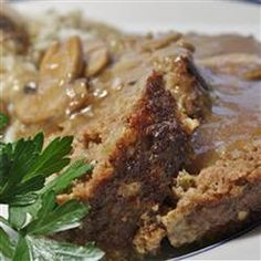 Meatloaf With Mushroom Gravy   1 1/2 pounds ground beef      3/4 cup fresh bread crumbs      1/2 cup chili sauce      1 egg      1/4 teaspoon salt      1/4 teaspoon freshly ground black pepper            1 cup fresh sliced mushrooms      2 tablespoons minced onion      1 tablespoon butter      1 cup beef broth      2 tablespoons water      1 tablespoon cornstarch   Preheat oven to 350 degrees