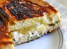 Classic grilled cheese tuna salad sandwich with tarragon.  Tuna melt recipe with French loaf bread, canned tuna, mayonnaise, cheddar cheese, parsley, lemon, tarragon.