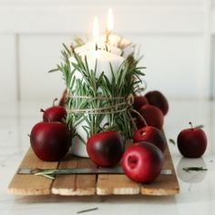 Christmas Table Decor This 10 minute holiday table decor idea wraps your candles in rosemary sprigs and garnishes your table with red apples. Apple Decorations, Handmade Christmas Decorations, Elegant Centerpieces, Baby Showers, Old World Christmas, Christmas Christmas, Christmas Candles, Holiday Tables, Paper Roses
