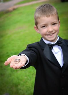 The ring bearer showing off the important part of his job. What a great photo for the wedding album.  The Historic Pinecrest Event Center, Colorado Springs Wedding Venue, Denver Wedding Venue, Palmer Lake Wedding Venue, Monument Wedding Venue, Colorado Ru