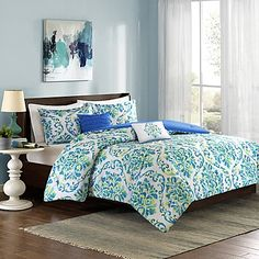 Intelligent Design's sunny Ari Comforter Set features a classic damask print in a lively palette of bright blues and greens. The comforter boasts a solid reverse for an elegant contrast while the set's 2 chic throw pillows add a perfect, finishing touch.