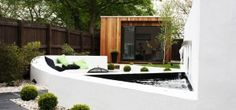 Contemporary garden studio room concrete seating water feature
