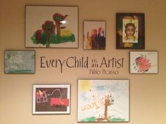 Playroom ideas: Decorating with kids art is a budget saver...less than $30 for the vinyl and the 7 frames