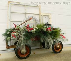 lovely vintage wagon, filled with greens, a lantern
