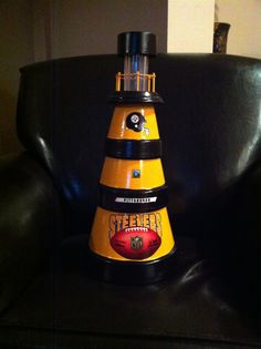 Pittsburgh steelers solar lighthouse made out of clay flower pots Clay Pot Projects, Clay Pot Crafts, Diy Clay, Dyi Crafts, Diy Projects, Clay Flower Pots, Flower Pot Crafts, Painted Clay Pots, Painted Flower Pots