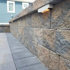 Beauty is in the eye of the beholder. Add a beautiful Cambridge Pavingstones with ArmorTec landscape wall in your backyard to add color in every coner.  Installation: Danway Pavers