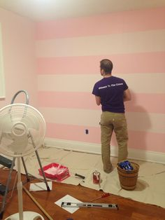Baby room painted! Elephant pink with satin stripes in the next colour on the paint strip. Benjamin Moore.