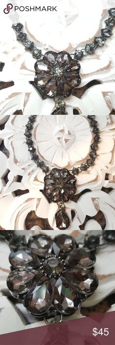 Black Grey Rhinestone Necklace Beautiful grey to blackish rhinestones necklace. Stones form a flower and it has a drop stone hanging from it. Jewelry Bracelets