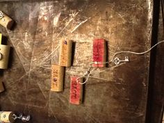 Cork magnets - use a serrated knife to slice a thin section from the front and back of the cork then cut in half. Stamp words. You can sponge some color. Use brads. Glue a magnet to the back.