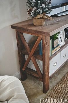 DIY TV Stand from craftsmandrive.com/ Minus the X and it is a  bit less country.
