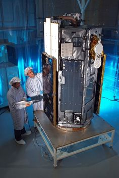 Engineers work on NASA's Orbiting Carbon Observatory 2, an Earth-orbiting satellite dedicated to tracking the amount of carbon dioxide in the planet's atmosphere.