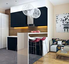 un bar blanc de cuisine et deux chaises de bar rouges, table basse en bois et sofa avec coussins barioolés