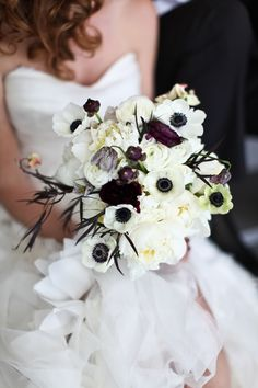 Cool black and white wedding bouquet. Find more ideas for how to plan an 80s party http://sparklerparties.com/rock-the-80s/