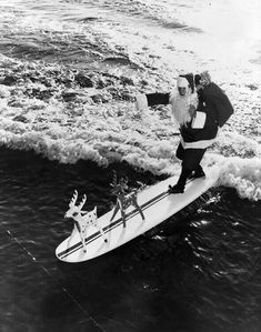 Sometimes Santa travels by sleigh. Other times he travels by surfboard.