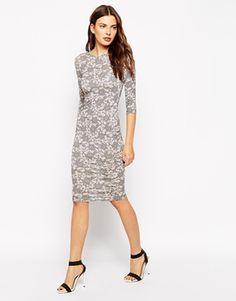Club L Body-Conscious Midi Dress in Bonded Star Lace Print