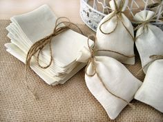 SET OF 100 Natural Rustic Linen Eco Wedding Favors Bag with natural jute twine drawstring. $115,00, via Etsy.