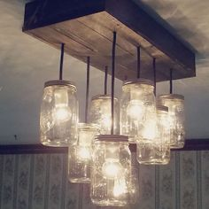 can totally make this....pallet, mason jar and bulbs...done deal!
