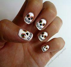 Lovely skull nail art.