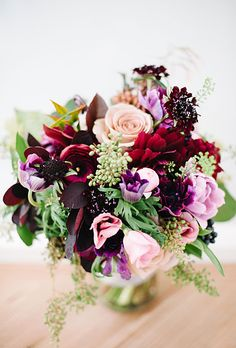 Brides: Modern Red and Purple Wedding Bouquet. Brooklyn-based Sprout Home gathered gem-colored ranunculus, anemones, dahlias, and garden roses to create the bride's full bouquet. Red Purple Wedding, Purple Wedding Bouquets, Flower Bouquet Wedding, Wedding Dresses, Bouquet Flowers, Purple Rose, Pink, Modern Wedding Flowers, Wedding Reception Flowers