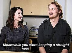 "(gif) - [What's your favorite scene you've done with each other?]  Sam: ""We did a scene, er, basically I had to put a shirt on...""  Cait: ""Oh God.""  Sam: ""Somehow I just could not get the shirt on.""  Cait: ""He hit me in the face with a sleeve, then he hit like the chandelier, then he had the shirt on back to front...  Sam: ""Meanwhile you were keeping a straight face.""  Cait: ""But I wasn't!"""