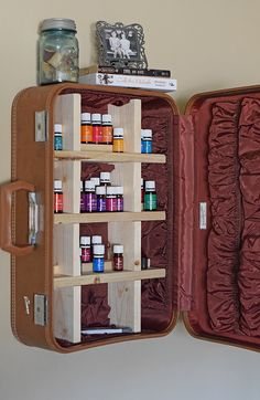 How to take a vintage suitcase and create a DIY suitcase cabinet for storage or home decoration. I needed either an essential oils case or a place for essential oils storage, and this is perfect! It definitely adds character to our living space… the stories that old suitcase could probably tell.