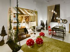 A swing,a treehouse for a bed and plenty of space,what kid wouldnt love this bedroom?