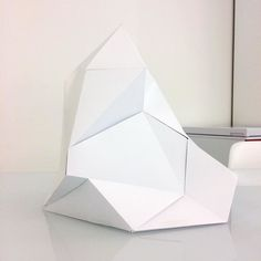 This my friends is a 3D lowpoly paper iceberg. The majority of my week at work has been spent trying to figure out how to make this pattern from a rough guide I found on google. What a challenge! Very pleased with the results.  #3D #papercraft #lowpoly #iceberg #design by charliprangley