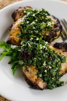 Grilled Chicken with Chimichurri Sauce - the chimichurri doubles as the marinade and sauce. A quick and easy, paleo, gluten-free, weeknight meal.