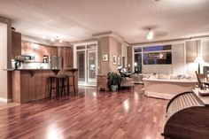 Fantastic main floor executive condo in wonderful Bridgeland, Calgary. Steps from shops and excellent restaurants, this two story home is located across a quiet one-way street from a park. Walk to down town, the zoo, Kensington. Fab!
