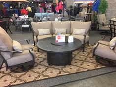 Castelle - Madrid Crescent Sofa. Swivel Lounge chairs and Fire Table available as additional items.