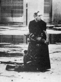 During an uprising in Puerto Cabello, Venezuela in 1962 – an episode known as the Porteñazo – the ruling dictatorship violently suppressed the insurgents. This picture depicts Padre Luis Maria Padilla supporting a wounded soldier. As he administers the last rites, the soldier is shot again.    The photograph, taken by Hector Rondon Lavera, won World Press Photograph of the Year in 1962.    - My Dad has this picture in his study. It gives me goose bumps every time I see it.