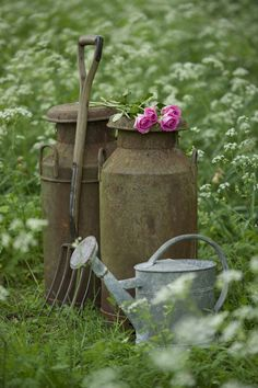 Nothing in your garden should look too polished. In that vein, it's best to use garden accessories that have a vintage feel, like a weathered pitchfork or an old galvanized steel watering can.   - CountryLiving.com Watering Cans, Country Life, Country Charm, Rustic Charm, Country Living, Vintage Garden Decor, Vintage Gardening, Organic Gardening, Milk Jugs