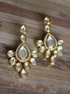 Gold finish long Kundan earrings - Sweta Sutariya - 1