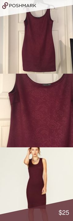 Burgundy body con tank dress Like new, burgundy bodycon tank dress. Pretty floral design woven in same color. 95% polyester and 5% spandex. Gorgeous color. Great for your holiday occasions. 3rd photo to show fit not actual dress. Juniors XL fits like a women's 8-10 possibly. Dresses Mini