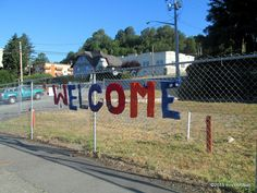 WELCOME to our town! Public art yarnbomb by nirvYARNah, 2015.