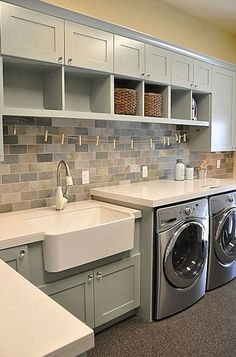soft green palate, big laundry sink, cupboards and flooring - love it!