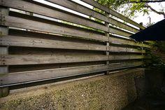 layered horizontal wood with concrete base
