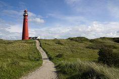 red lighthouse on Schiermonnikoog island - Friesland, The Netherlands Lighthouse Lighting, Show Me The Way, Amazing Race, Portland Maine, Windmill, Netherlands, Holland, Paths, Amsterdam