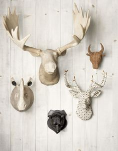 faux taxidermy heads - want to do this in our new house on the vaulted ceiling wall but my husband thinks I'm nuts. He'll love it once it's done right?
