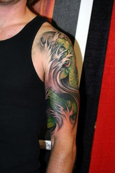 Beautiful koi tattoo by Jeff Gogue - love the way it doesn't just end or begin anywhere
