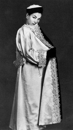 Lucky in sumptious evening coat of white satin embroidered in gold, silver and pearls by Christian Dior, photo by Georges Saad, 1951