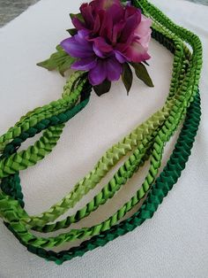 Braided ribbon with tropical flower lei Ribbon Lei, Diy Ribbon, Ribbon Crafts, Ribbon Colors, Diy Graduation Gifts, Graduation Leis, Money Lei, Delphinium Flowers, Flower Lei