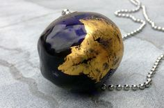 Trinity pendant. NZ$120 Large translucent cobalt blue hollow bead with fine silver and 24 carat gold leaf, and sterling silver bead caps on a 1.5mm sterling silver ball chain. Buy from felt.co.nz