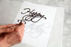 How to Write on a Cake (video on folding parchment pastry bag)