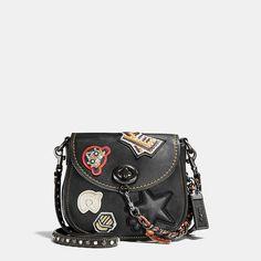 bb9bbf6cc3 17 Varsity-Patch Leather Saddle Bag