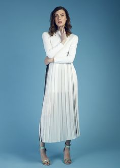 We love the sheer pleats and long sleeves on our Long Sleeve Pleated Maxi Dress by Korean designer, Post December. Get yours now on portemode.com today!