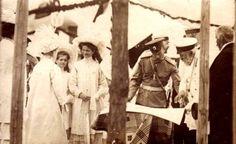 Tsarina Alexandra, Grand Duchesses Maria and Olga and Nicholas II with an officer
